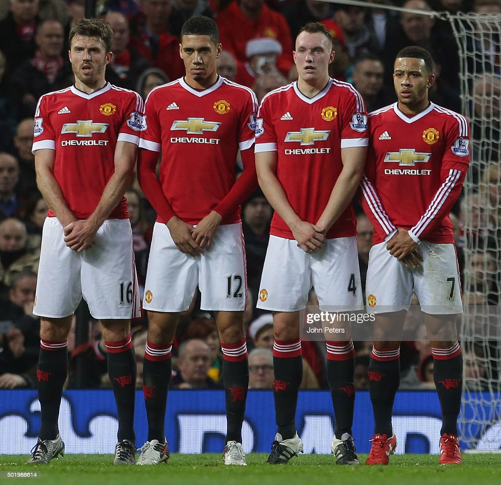 <a gi-track='captionPersonalityLinkClicked' href=/galleries/search?phrase=Michael+Carrick&family=editorial&specificpeople=214599 ng-click='$event.stopPropagation()'>Michael Carrick</a>, <a gi-track='captionPersonalityLinkClicked' href=/galleries/search?phrase=Chris+Smalling&family=editorial&specificpeople=5964313 ng-click='$event.stopPropagation()'>Chris Smalling</a>, <a gi-track='captionPersonalityLinkClicked' href=/galleries/search?phrase=Phil+Jones+-+Soccer+Player&family=editorial&specificpeople=7841291 ng-click='$event.stopPropagation()'>Phil Jones</a> and <a gi-track='captionPersonalityLinkClicked' href=/galleries/search?phrase=Memphis+Depay&family=editorial&specificpeople=7189987 ng-click='$event.stopPropagation()'>Memphis Depay</a> of Manchester United defend a free-kick during the Barclays Premier League match between Manchester United and Norwich City at Old Trafford on December 19, 2015 in Manchester, England.