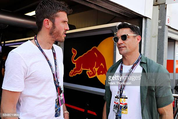 Michael Carrick football player talks with Dan Carter rugby player outside the Red Bull Racing garage ahead of qualifying for the Monaco Formula One...