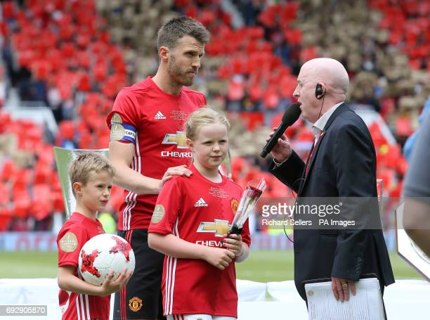Michael Carrick next to his children Jacey and Louise before his Testimonial match