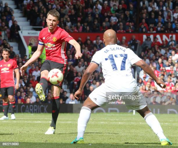 Michael Carrick of Manchester United '08 XI in action with Marcos Senna of Michael Carrick AllStars during the Michael Carrick Testimonial match...