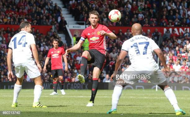 Michael Carrick of Manchester United '08 XI in action with Richard Garcia and Marcos Senna of Michael Carrick AllStars during the Michael Carrick...