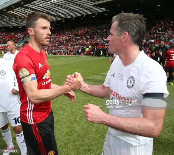 Michael Carrick of Manchester United '08 XI speaks to Jamie Carragher after the Michael Carrick Testimonial match between Manchester United '08 XI...