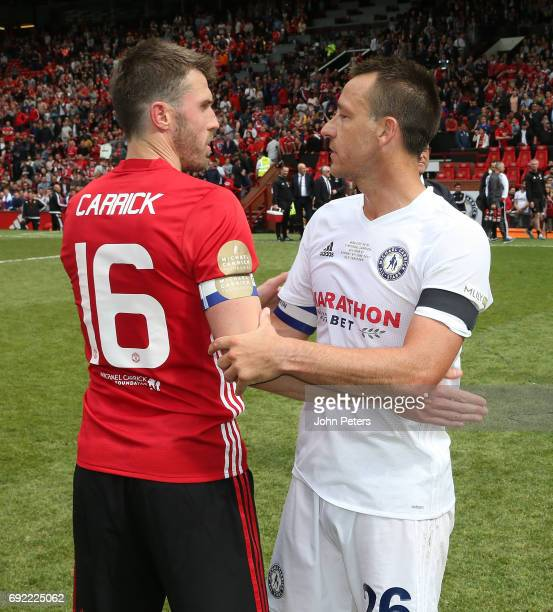 Michael Carrick of Manchester United '08 XI speaks to John Terry after the Michael Carrick Testimonial match between Manchester United '08 XI and...