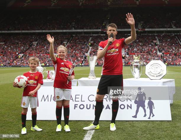 Michael Carrick of Manchester United '08 XI speaks to the crowd ahead of the Michael Carrick Testimonial match between Manchester United '08 XI and...