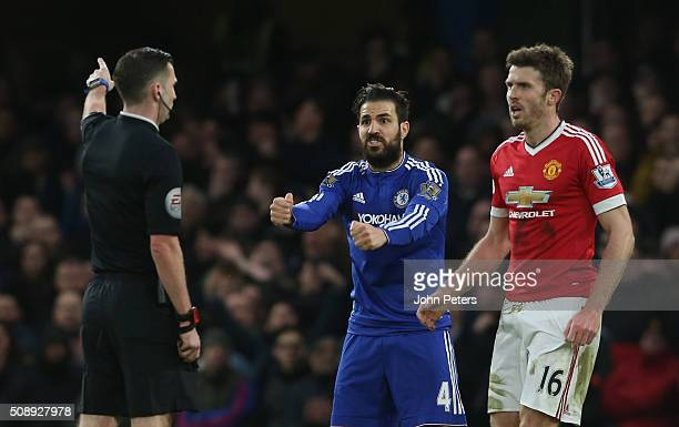 Michael Carrick of Manchester United and Cesc Fabregas of Chelsea speak to referee Michael Oliver during the Barclays Premier League match between...