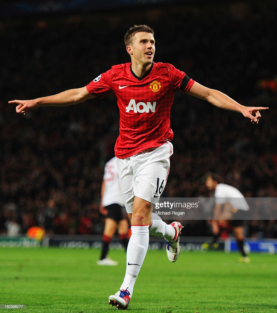 <a gi-track='captionPersonalityLinkClicked' href=/galleries/search?phrase=Michael+Carrick&family=editorial&specificpeople=214599 ng-click='$event.stopPropagation()'>Michael Carrick</a> of Manchester United celebrates as he scores their first goal during the UEFA Champions League Group H match between Manchester United and Galatasaray at Old Trafford on September 19, 2012 in Manchester, England.