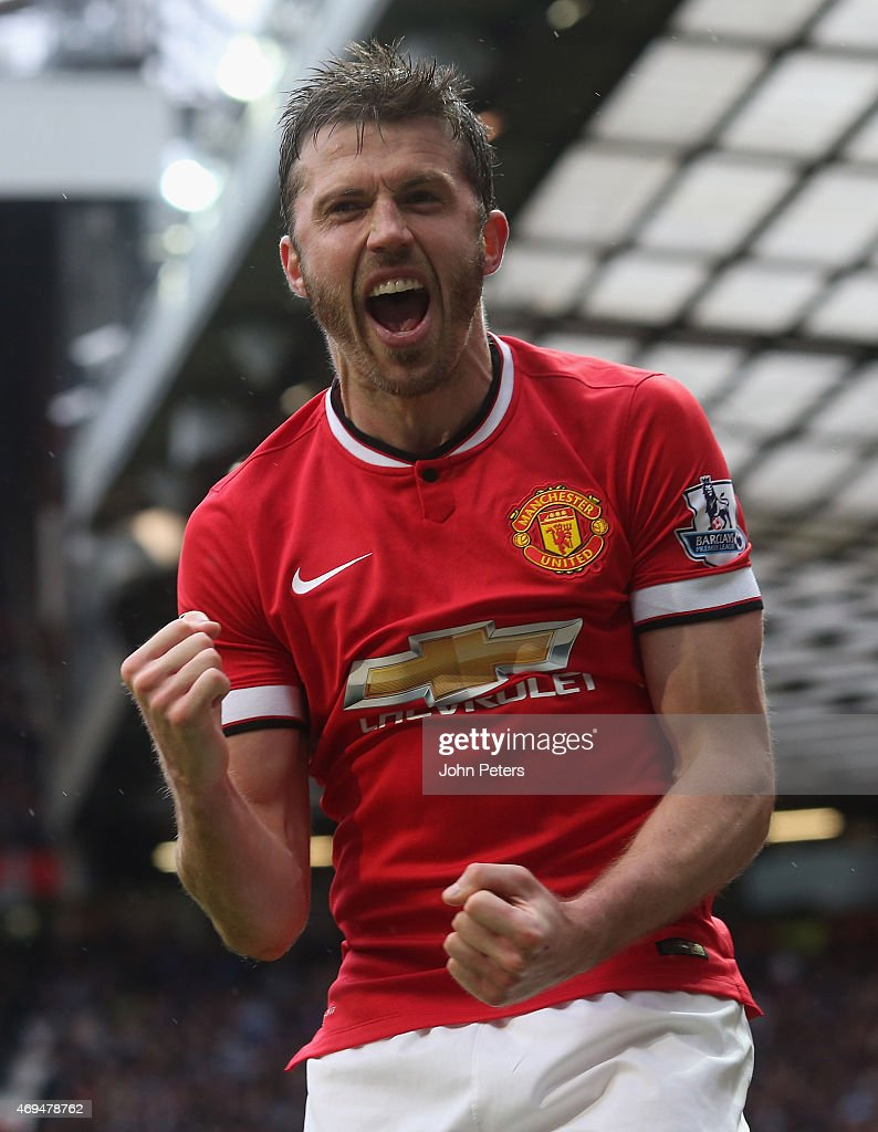 <a gi-track='captionPersonalityLinkClicked' href=/galleries/search?phrase=Michael+Carrick&family=editorial&specificpeople=214599 ng-click='$event.stopPropagation()'>Michael Carrick</a> of Manchester United celebrates Juan Mata scoring their third goal during the Barclays Premier League match between Manchester United and Manchester City at Old Trafford on April 12, 2015 in Manchester, England.