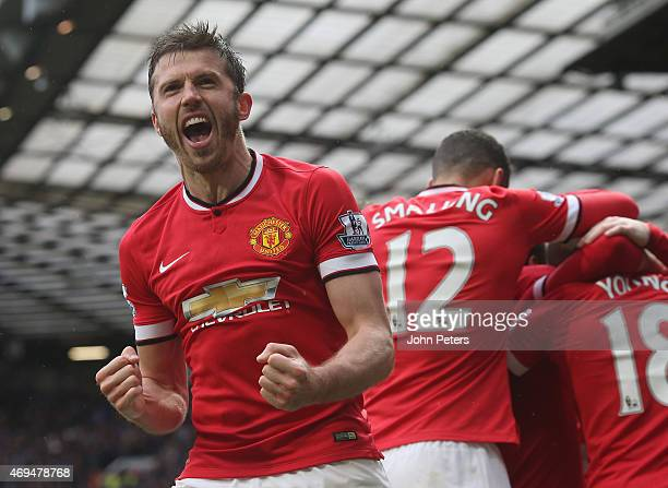 Michael Carrick of Manchester United celebrates Juan Mata scoring their third goal during the Barclays Premier League match between Manchester United...