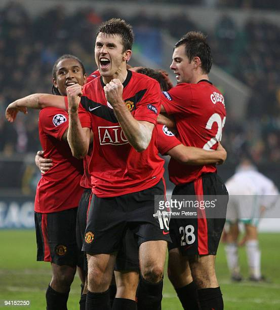 Michael Carrick of Manchester United celebrates Michael Owen scoring their second goal during the UEFA Champions League match between VfL Wolfsburg...