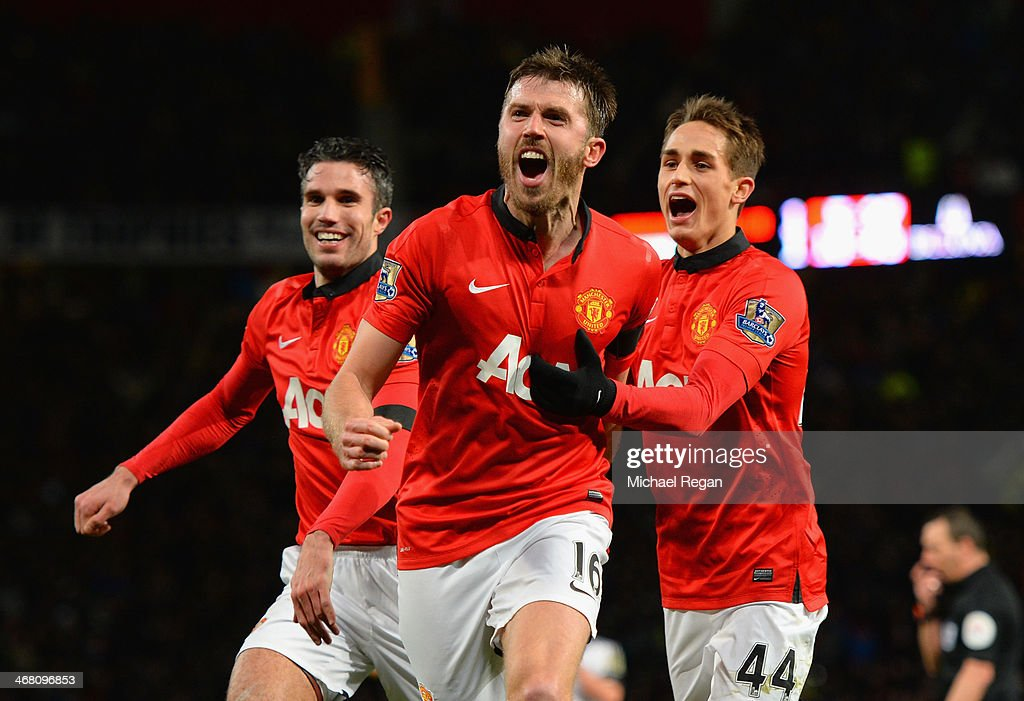 Michael Carrick of Manchester United celebrates scoring his team's second goal with Adnan Januzaj during the Barclays Premier League match between...