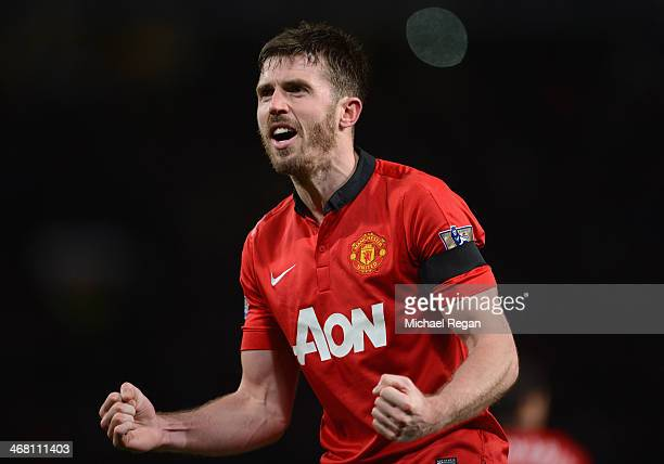 Michael Carrick of Manchester United celebrates scoring his team's second goal during the Barclays Premier League match between Manchester United and...