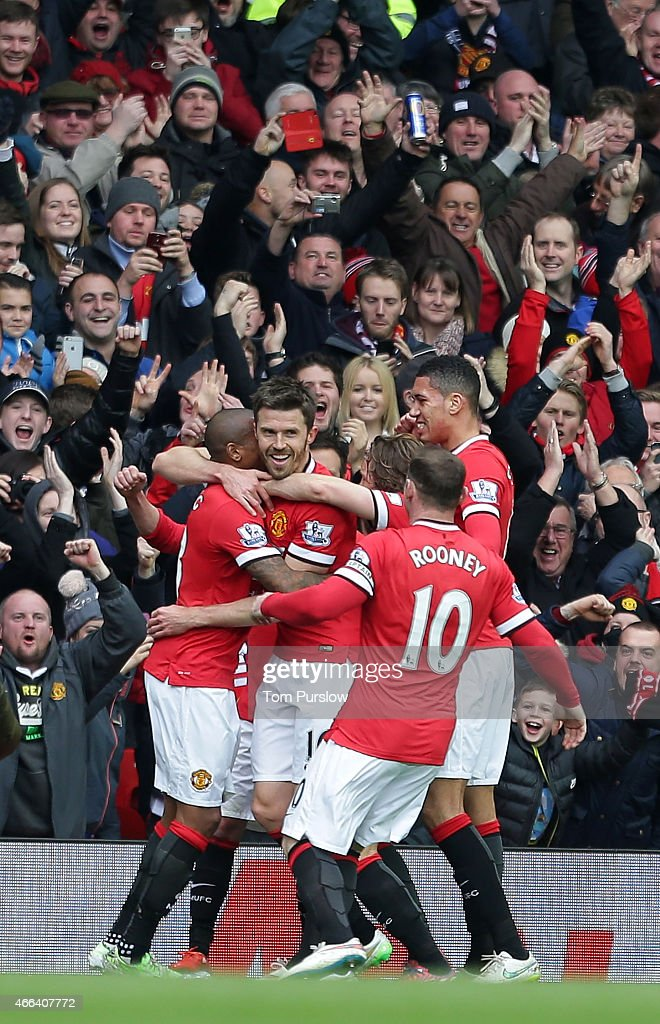 Michael Carrick of Manchester United celebrates scoring their second goal during the Barclays Premier League match between Manchester United and...