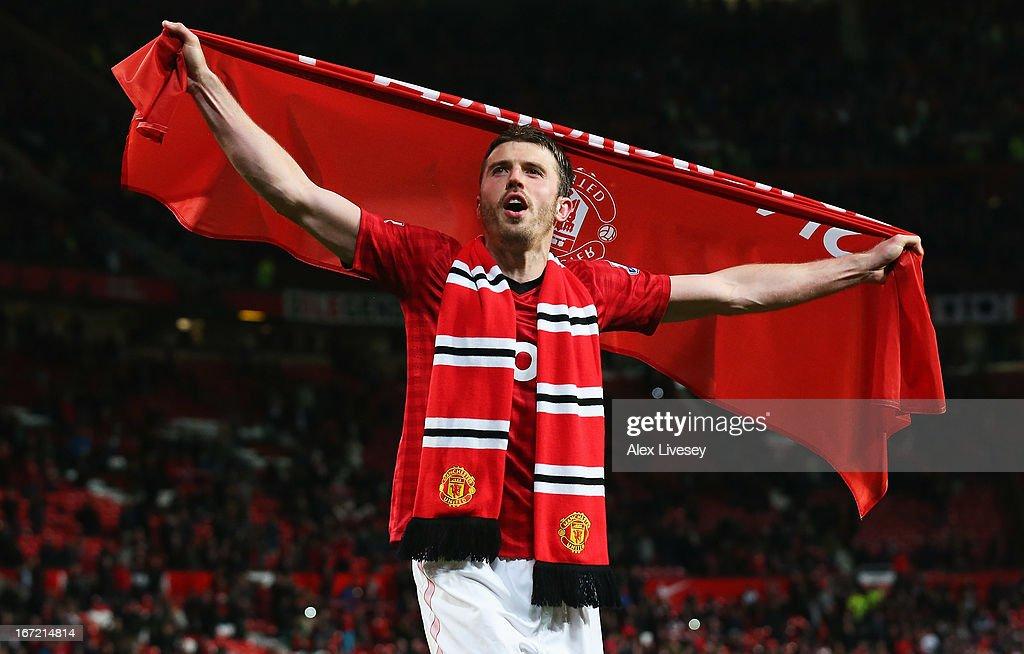 Michael Carrick of Manchester United celebrates victory and winning the Premier League title after the Barclays Premier League match between...