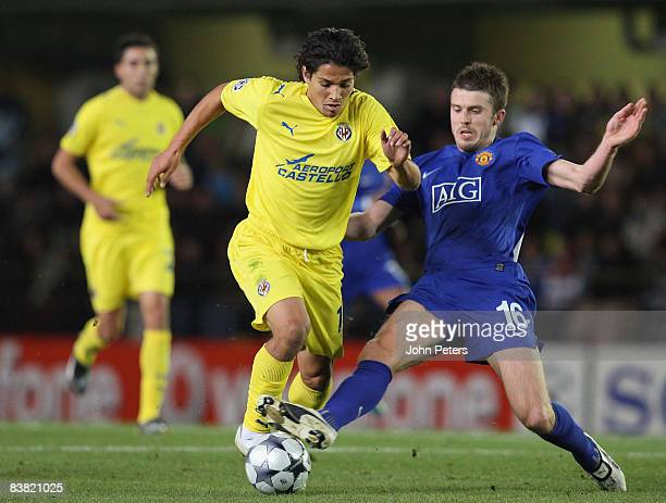 Michael Carrick of Manchester United clashes with Mati Fernandez of Villarreal during the UEFA Champions League Group E game between Villarreal and...
