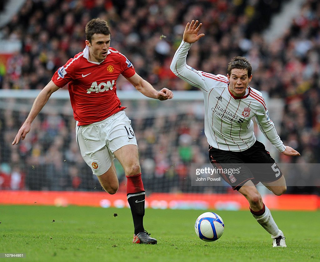 <a gi-track='captionPersonalityLinkClicked' href=/galleries/search?phrase=Michael+Carrick&family=editorial&specificpeople=214599 ng-click='$event.stopPropagation()'>Michael Carrick</a> of Manchester United competes with <a gi-track='captionPersonalityLinkClicked' href=/galleries/search?phrase=Daniel+Agger&family=editorial&specificpeople=605441 ng-click='$event.stopPropagation()'>Daniel Agger</a> of Liverpool during the FA Cup Sponsored by E.ON 3rd Round match between Manchester United and Liverpool at Old Trafford on January 9, 2011 in Manchester, England.