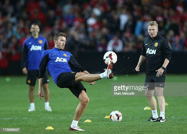 Michael Carrick of Manchester United controls the ball as Manager David Moyes watches during a Manchester United training session at Allianz Stadium...