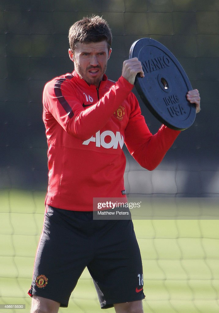Michael Carrick of Manchester United in action during a first team training session at Aon Training Complex on October 2 2014 in Manchester England