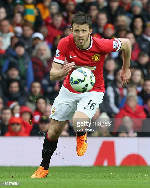 Michael Carrick of Manchester United in action during the Barclays Premier League match between Manchester United and Manchester City at Old Trafford...