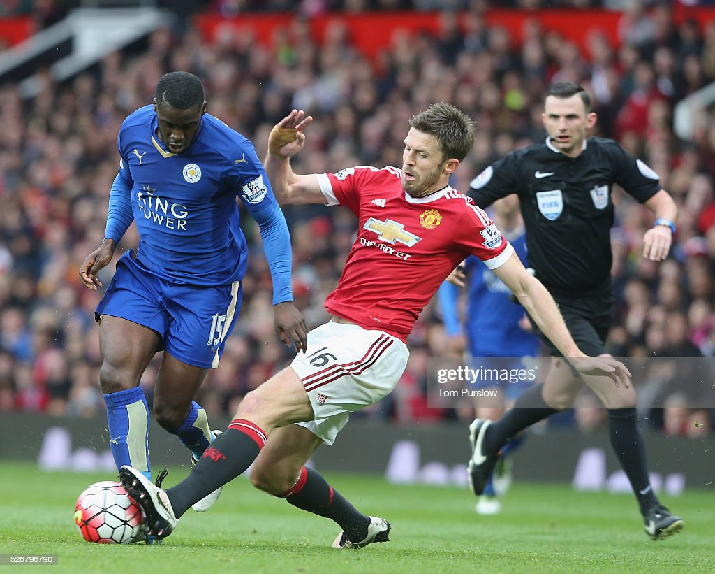 <a gi-track='captionPersonalityLinkClicked' href=/galleries/search?phrase=Michael+Carrick&family=editorial&specificpeople=214599 ng-click='$event.stopPropagation()'>Michael Carrick</a> of Manchester United in action with Jeffrey Schlupp of Leicester City during the Barclays Premier League match between Manchester United and Leicester City at Old Trafford on May 1, 2016 in Manchester, England.