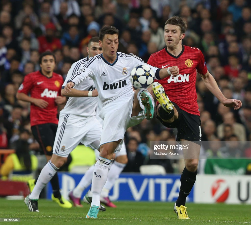 Michael Carrick of Manchester United in action with Mesut Ozil of Real Madrid during the UEFA Champions League Round of 16 first leg match between Real Madrid and Manchester United at Estadio Santiago Bernabeu on February 13, 2013 in Madrid, Spain.