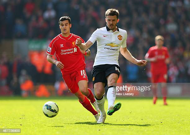 Michael Carrick of Manchester United is closed down by Philippe Coutinho of Liverpool during the Barclays Premier League match between Liverpool and...