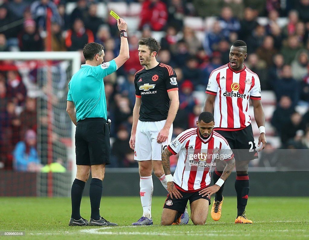 <a gi-track='captionPersonalityLinkClicked' href=/galleries/search?phrase=Michael+Carrick&family=editorial&specificpeople=214599 ng-click='$event.stopPropagation()'>Michael Carrick</a> of Manchester United is shown a yellow card by referee <a gi-track='captionPersonalityLinkClicked' href=/galleries/search?phrase=Andre+Marriner&family=editorial&specificpeople=221003 ng-click='$event.stopPropagation()'>Andre Marriner</a> after fouling <a gi-track='captionPersonalityLinkClicked' href=/galleries/search?phrase=Yann+M%27Vila&family=editorial&specificpeople=6130765 ng-click='$event.stopPropagation()'>Yann M'Vila</a> of Sunderland during the Barclays Premier League match between Sunderland and Manchester United at the Stadium of Light on February 13, 2016 in Sunderland, England.