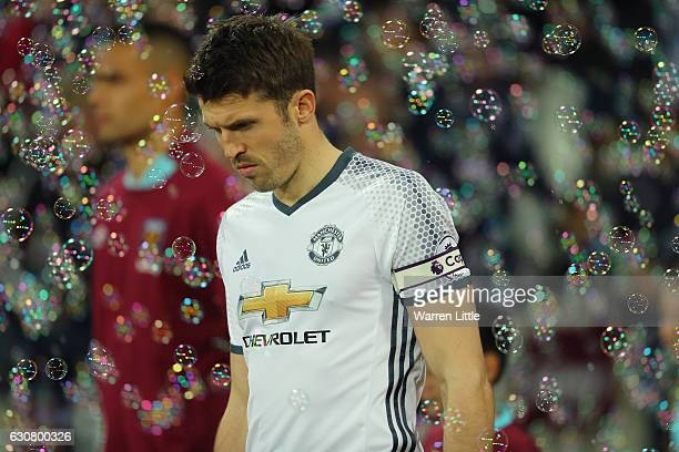 Michael Carrick of Manchester United leads his team out prior to the Premier League match between West Ham United and Manchester United at London...