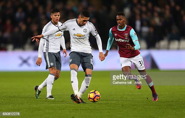 Michael Carrick of Manchester United passes past Edimilson Fernandes of West Ham during the Premier League match between West Ham United and...