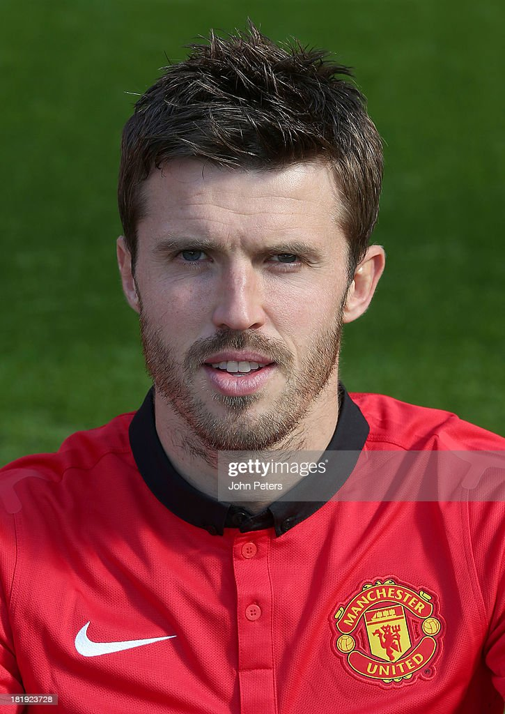 Michael Carrick of Manchester United poses at the annual club photocall at Old Trafford on September 26 2013 in Manchester England