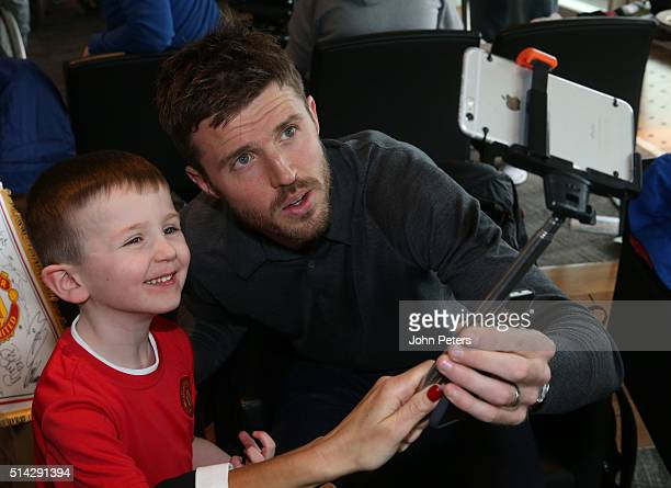 Michael Carrick of Manchester United poses with Jack during the MU Foundation's Dream Day where poorly children meet the Manchester United team at...