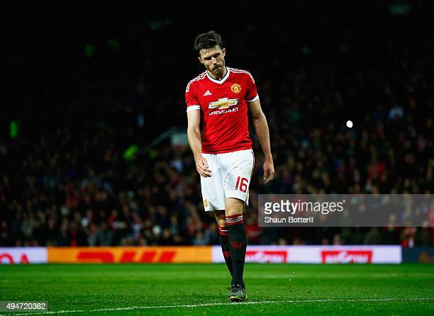 Michael Carrick of Manchester United reacts after failing to score from the penalty spot in the penalty shoot out during the Capital One Cup Fourth...