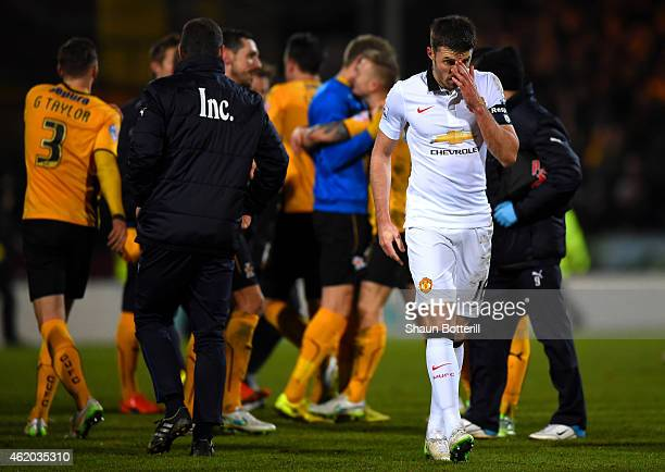 Michael Carrick of Manchester United reacts as Cambridge United players celebrate during the FA Cup Fourth Round match between Cambridge United and...