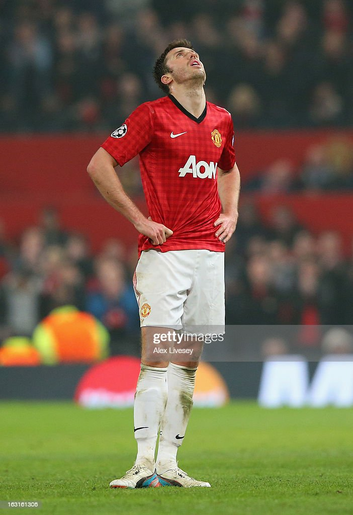 <a gi-track='captionPersonalityLinkClicked' href=/galleries/search?phrase=Michael+Carrick&family=editorial&specificpeople=214599 ng-click='$event.stopPropagation()'>Michael Carrick</a> of Manchester United reacts during the UEFA Champions League Round of 16 Second leg match between Manchester United and Real Madrid at Old Trafford on March 5, 2013 in Manchester, United Kingdom.