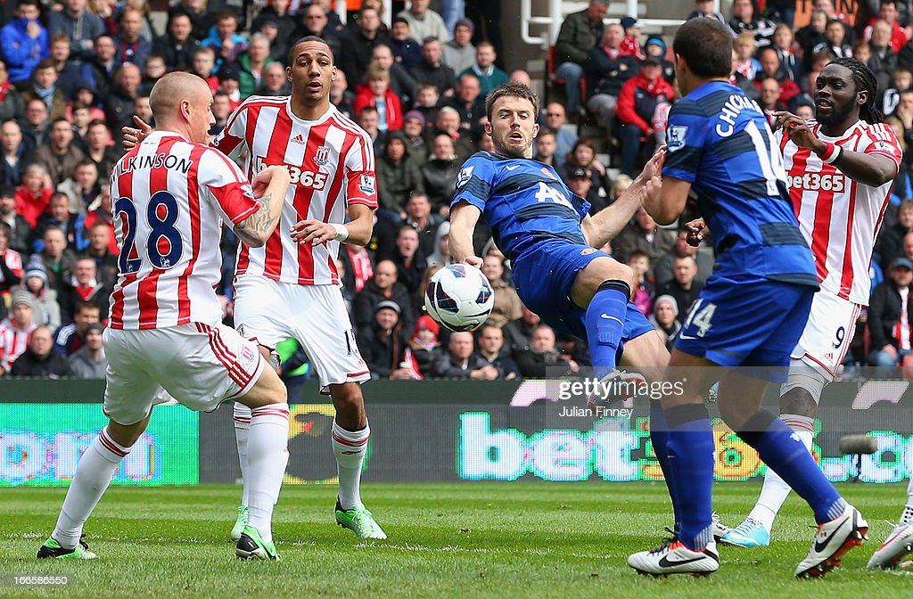 Michael Carrick of Manchester United scores the opening goal during the Barclays Premier League match between Stoke City and Manchester United at the...