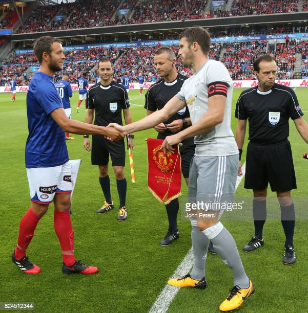 Michael Carrick of Manchester United shakes hands with the Valerenga Captain prior to the preseason friendly match between Valerenga and Manchester...