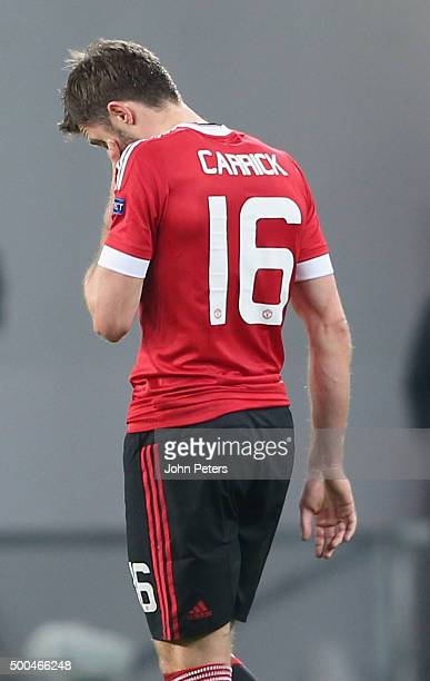Michael Carrick of Manchester United shows his disappointment during the UEFA Champions League match between VfL Wolfsburg and Manchester United at...