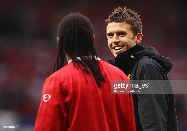 Michael Carrick of Manchester United talks to team mate Anderson prior to the Barclays Premier League match between West Ham United and Manchester...
