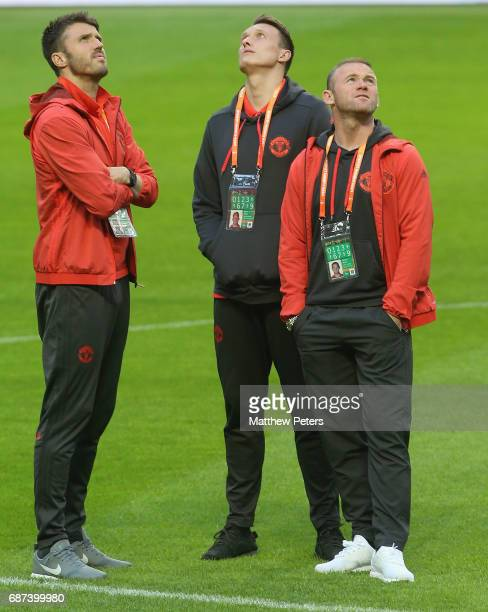 Michael Carrick Phil Jones and Wayne Rooney of Manchester United walk on the pitch ahead of the UEFA Europa League Final at Friends Arena on May 23...