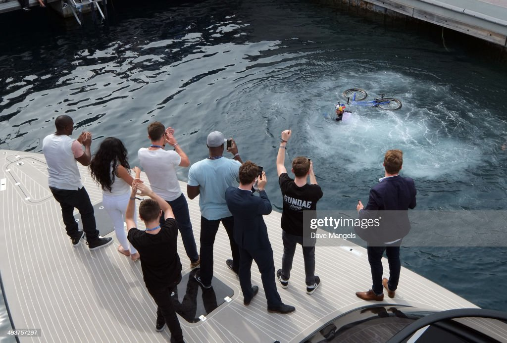 Michael Carrick, Reggie Bush, Lilit Avagyan, Benedict Cumberbatch and Disclosure watch street trials rider Danny MacAskill front flip off of the Red Bull Energy Station during the Monaco Formula One Grand Prix at Circuit de Monaco on May 25, 2014 in Monte-Carlo, Monaco.