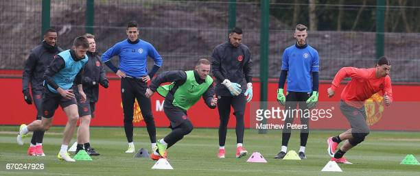 Michael Carrick Wayne Rooney and Zlatan Ibrahimovic of Manchester United in action during a first team training session at Aon Training Complex on...