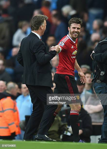 Michael Carrickof Manchester United and Louis van Gaal Manager of Manchester United celebrate victory after the Barclays Premier League match between...