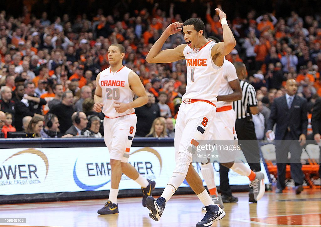 Michael Carter-Williams #1 and Brandon Triche #20 of the Syracuse Orange celebrate after a play during the game against the Cincinnati Bearcats during the game at the Carrier Dome on January 21, 2013 in Syracuse, New York.