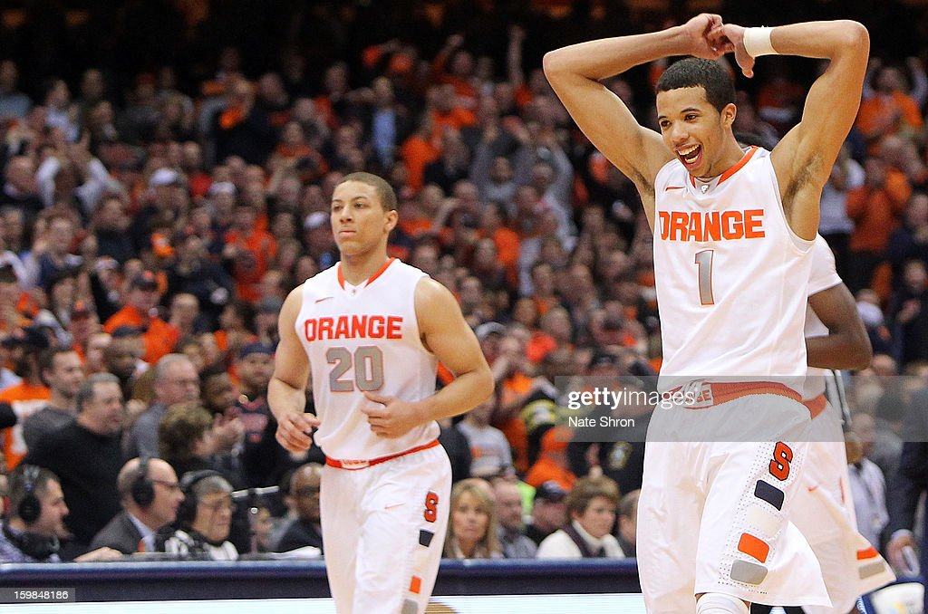 Michael Carter-Williams #1 and Brandon Triche #20 of the Syracuse Orange celebrate after a play during the game against the Cincinnati Bearcats at the Carrier Dome on January 21, 2013 in Syracuse, New York.
