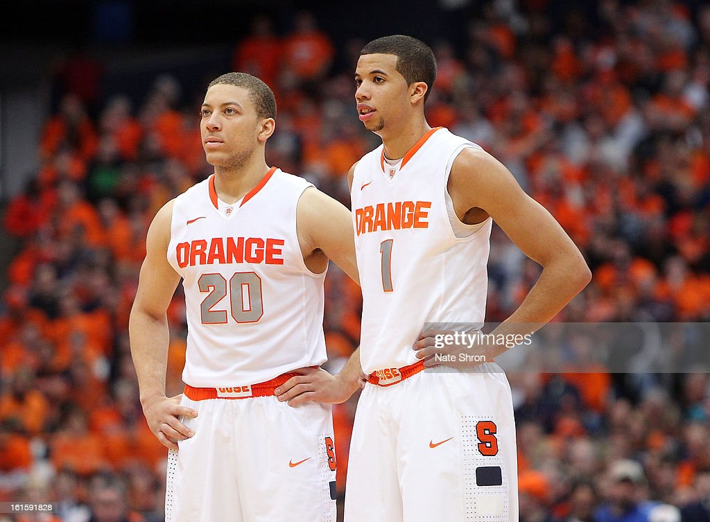 Michael Carter-Williams #1 and Brandon Triche #20 of the Syracuse Orange look on during a break in play in the game against the St. John's Red Storm at the Carrier Dome on February 10, 2013 in Syracuse, New York.