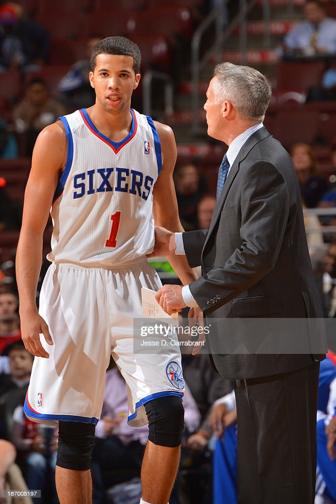 <a gi-track='captionPersonalityLinkClicked' href=/galleries/search?phrase=Michael+Carter-Williams&family=editorial&specificpeople=7621167 ng-click='$event.stopPropagation()'>Michael Carter-Williams</a> #1 and <a gi-track='captionPersonalityLinkClicked' href=/galleries/search?phrase=Brett+Brown&family=editorial&specificpeople=2119406 ng-click='$event.stopPropagation()'>Brett Brown</a> of the Philadelphia 76ers talk against the Golden State Warriors at the Wells Fargo Center on November 4, 2013 in Philadelphia, Pennsylvania.