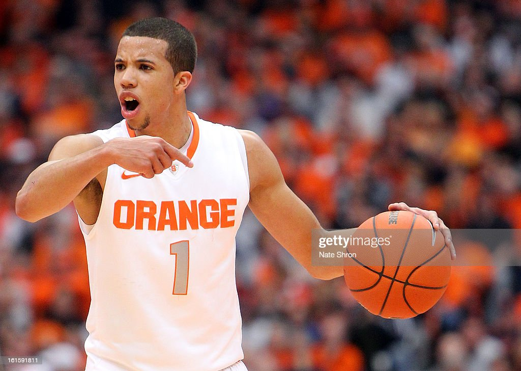 Michael Carter-Williams #1 gestures to teamates as he dribbles the ball down the court in the game against the St. John's Red Storm at the Carrier Dome on February 10, 2013 in Syracuse, New York.