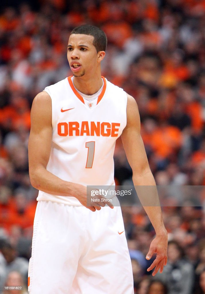 Michael Carter-Williams #1 gestures to teamates during play in the game against the St. John's Red Storm at the Carrier Dome on February 10, 2013 in Syracuse, New York.