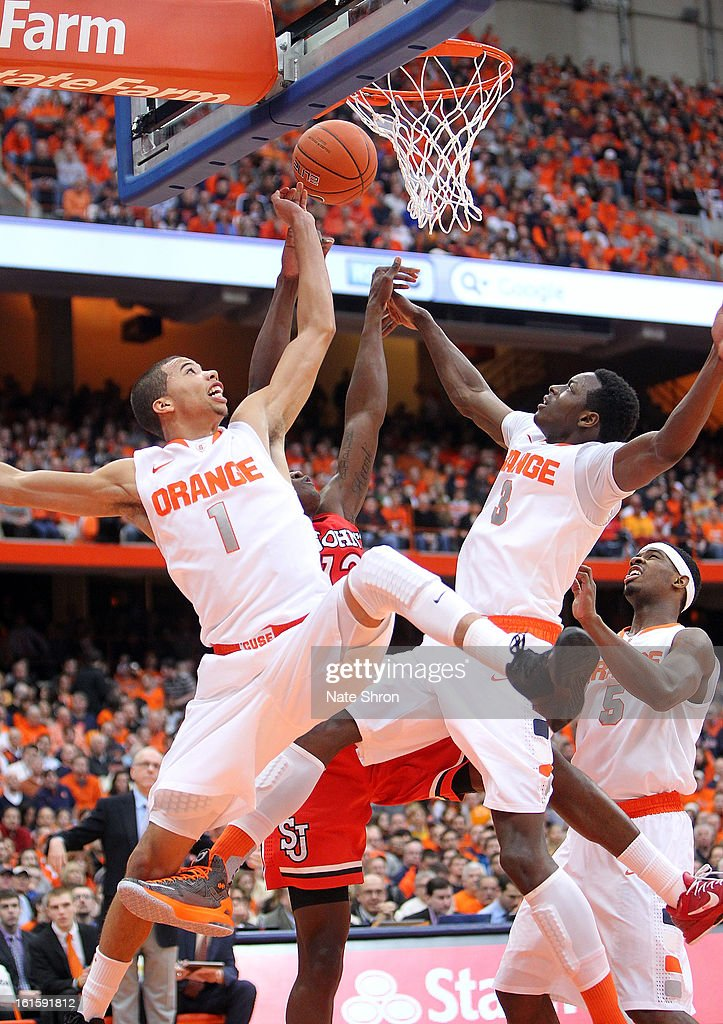 Michael Carter-Williams #1, Jerami Grant #3 and C.J. Fair #5 of the Syracuse Orange reach for the rebound against Chris Obekpa #12 of the St. John's Red Storm during the game at the Carrier Dome on February 10, 2013 in Syracuse, New York.