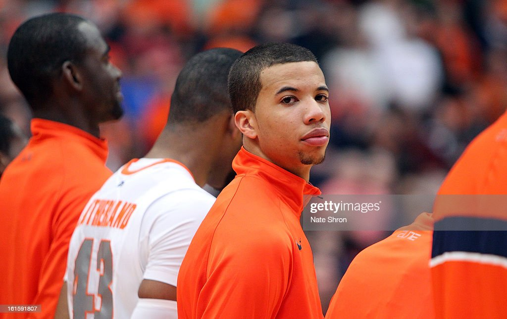 Michael Carter-Williams #1 looks on as he stands in line with teamates during the National Anthem prior to the game against the St. John's Red Storm at the Carrier Dome on February 10, 2013 in Syracuse, New York.