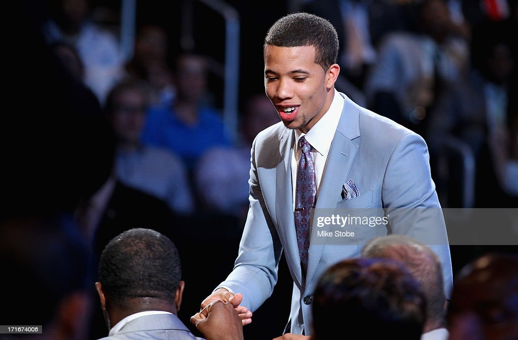 Michael Carter-Williams of Syracuse greets friends and family in the green room after he was drafted #11 overall in the first round by the Philadelphia 76ers during the 2013 NBA Draft at Barclays Center on June 27, 2013 in in the Brooklyn Bourough of New York City.
